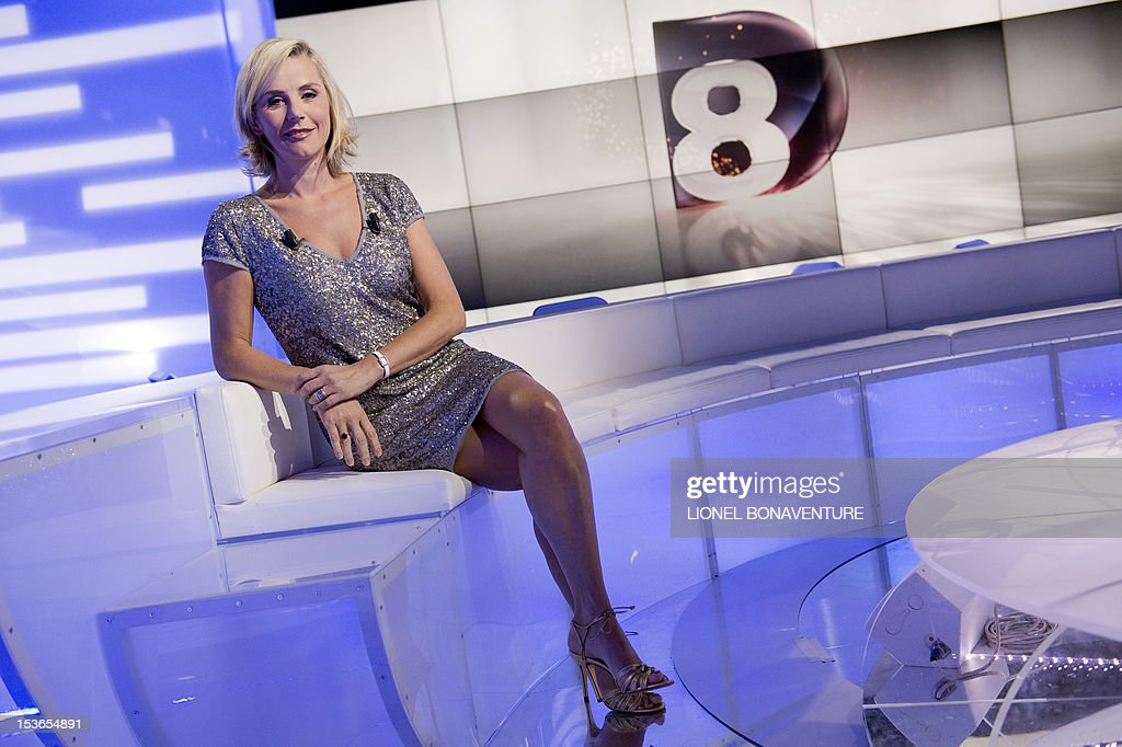 French journalist Laurence Ferrari poses during the official launching of the French D8 TV channel on October 7, 2012 in Paris. D8 is the new name of Direct 8 that Canal + group bought to French Bollore group. Ferrari will host the program 'Le Grand 8' with former minister Roselyne Bachelot, Hapsatou Sy and journalists Elisabeth Bost and Audrey Pulvar.
