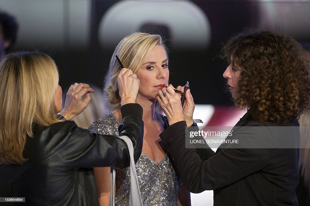 French journalist Laurence Ferrari receives make-up during the official launching of the French D8 TV channel on October 7, 2012 in Paris. D8 is the new name of Direct 8 that Canal + group bought to French Bollore group. Ferrari will host the program 'Le Grand 8' with former minister Roselyne Bachelot, Hapsatou Sy and journalists Elisabeth Bost and Audrey Pulvar.