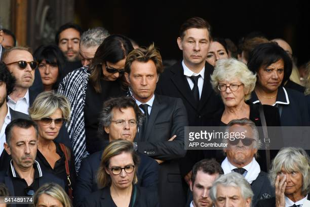 French journalist Laurent Delahousse and guests leave the SaintSulpice church to attend the funeral of late actress Mireille Darc on September 1 2017...