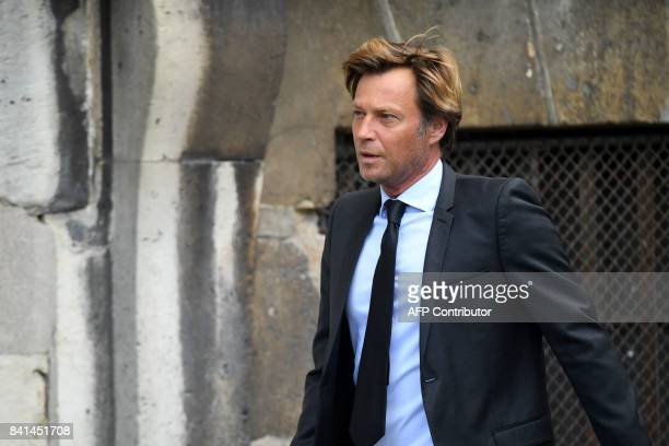 French journalist Laurent Delahousse arrives at the SaintSulpice church to attend the funeral of late actress Mireille Darc on September 1 2017 in...