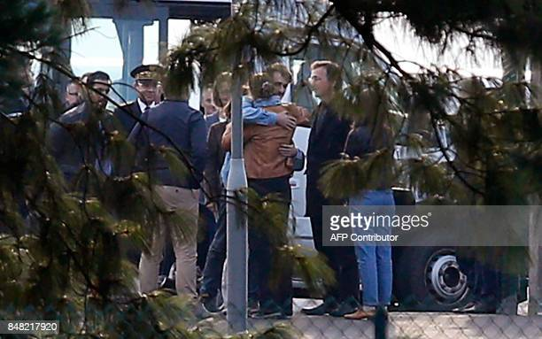 French journalist Loup Bureau embraces family members and supporters after his arrival at RoissyCharles de Gaulle Airport on the outskirts of Paris...