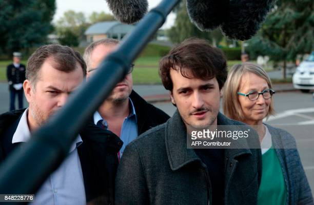French journalist Loup Bureau is watched by French Culture Minister Françoise Nyssen as he addresses media representatives after his arrival at...