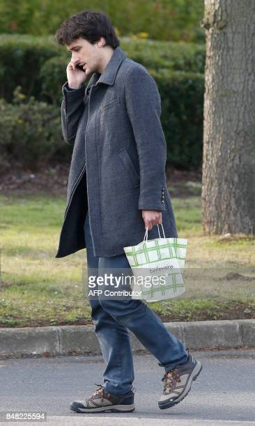 French journalist Loup Bureau speaks on a cellular telephone after his arrival at RoissyCharles de Gaulle Airport on the outskirts of Paris on...