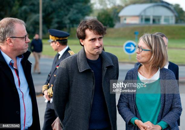 French journalist Loup Bureau stands with French Culture Minister Françoise Nyssen as he addresses media representatives after his arrival at...