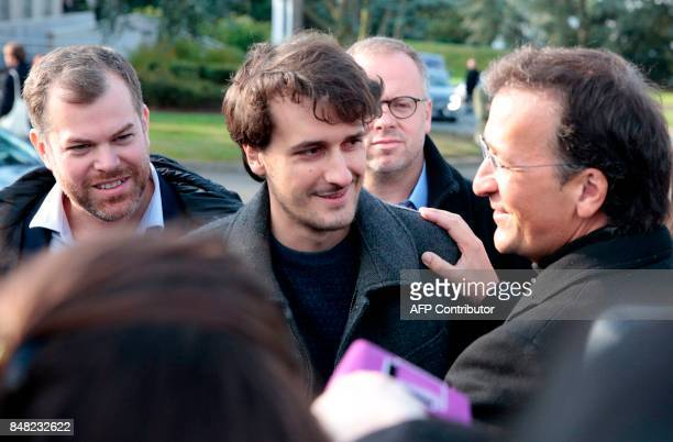 French journalist Loup Bureau stands with his father Loic Bureau and others as he addresses media representatives after his arrival at RoissyCharles...