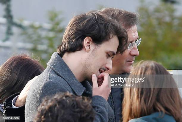 French journalist Loup Bureau stands with supporters and family members including his father Loic Bureau after addressing media representatives after...