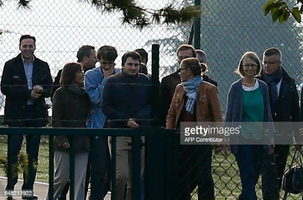French journalist Loup Bureau walks with family members and supporters including French Culture Minister Françoise Nyssen after his arrival at...