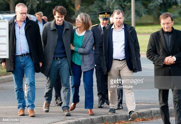 French journalist Loup Bureau walks with family members and supporters including French Culture Minister Françoise Nyssen and his father Loic Bureau...