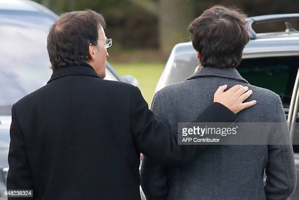 French journalist Loup Bureau walks with his father Loic Bureau after addressing media representatives after his arrival at RoissyCharles de Gaulle...