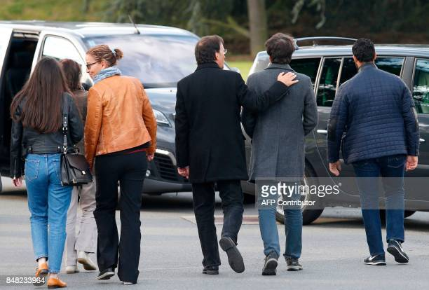 French journalist Loup Bureau walks with supporters and family members including his father Loic Bureau after addressing media representatives after...