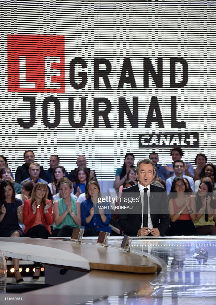 French journalist Michel Denisot is pictured on the set of French TV Canal+ talk show 'Le Grand Journal,' he anchored for the last time on June 27, 2013 in Paris. AFP PHOTO / MARTIN BUREAU BUREAU