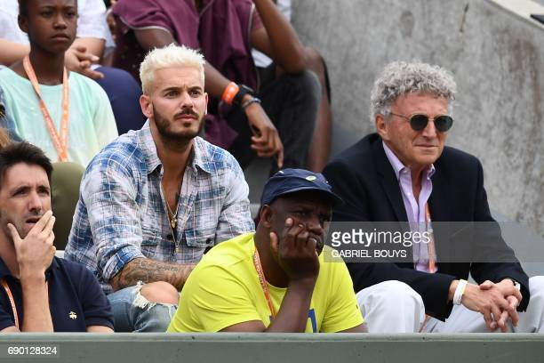 French journalist Nelson Monfort and French singer M Pokora attend a tennis match at the Roland Garros 2017 French Open on May 30 2017 in Paris / AFP...
