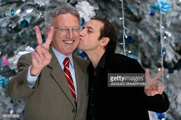French journalist Nelson Montfort and ice skater Philippe Candeloro pose on December 17 2013 in Paris during the presentation of the French TV France...