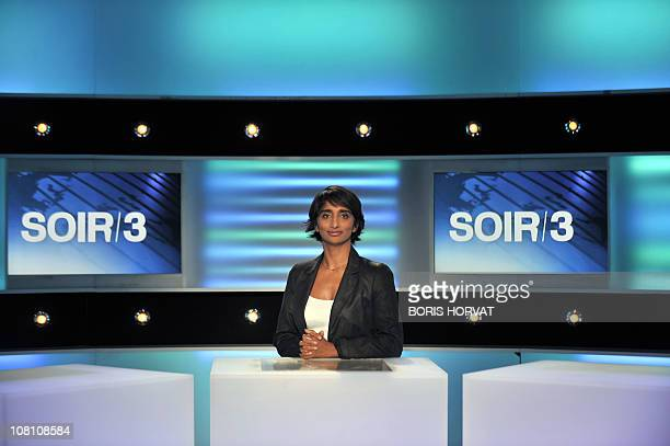 French journalist Patricia Loison poses on January 13 2011 on a set of French channel France 3 in Paris Loison will present the 7pm news 'Soir 3' on...