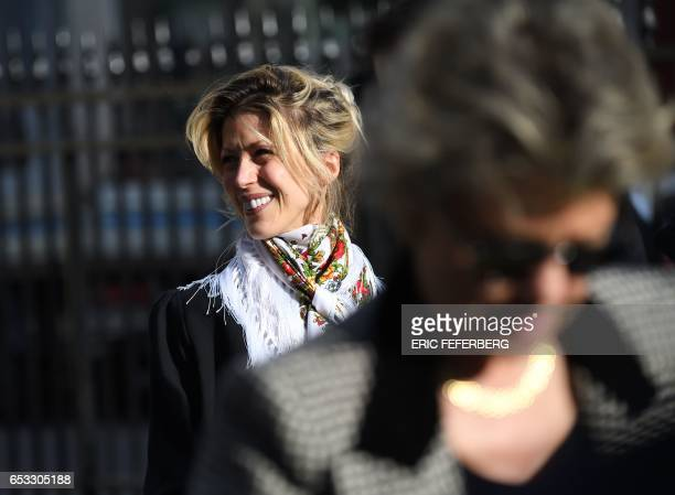 French journalist Tristane Banon and her mother former politician Anne Mansouret leave the church of SaintPierre du Gros Caillou in Paris on March 14...