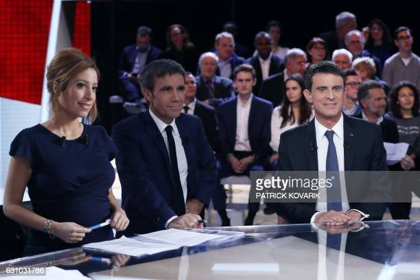 French journalists and television hosts David Pujadas and Lea Salame pose with former French prime minister and candidate for the left wing primaries...