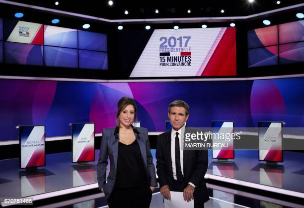 French journalists and television hosts David Pujadas and Lea Salame pose before a special political TV show entitled '15mn to convince' at the...