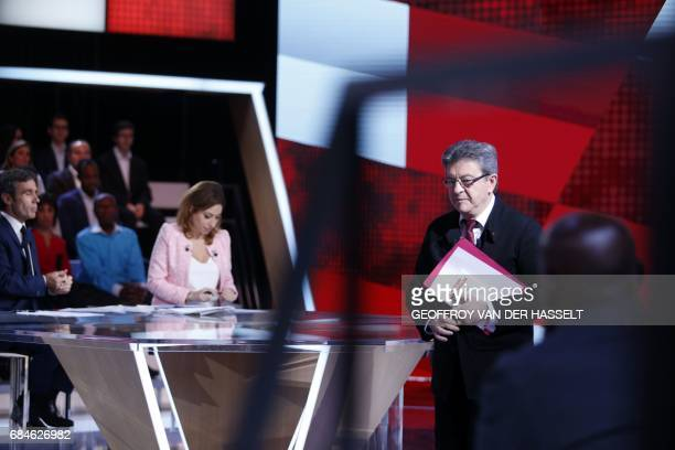 French journalists and TV hosts David Pujadas and Lea Salame sit as former French presidential candidate JeanLuc Melenchon and candidate in Marseille...