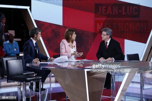 French journalists and TV hosts David Pujadas and Lea Salame talk with former French presidential candidate JeanLuc Melenchon and candidate in...