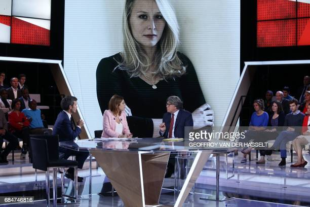 French journalists and TV hosts David Pujadas and Lea Salame talk with farright Front National party's MP and candidate in the Gard department for...