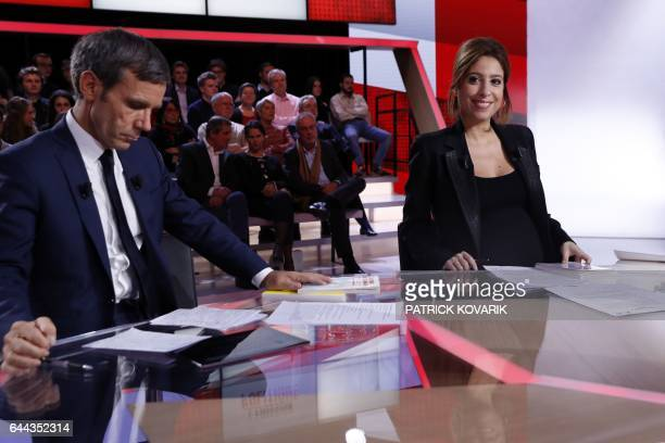 French journalists and TV hosts David Pujadas and Lea Salame wait prior to the show 'L'Emission politique' with presidential election candidate for...