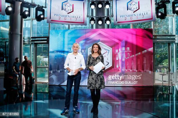 French journalists Gilles Bouleau and AnneClaire Coudray pose on the set of the French TV channel TF1 on April 21 2017 in a BoulogneBillancourt near...