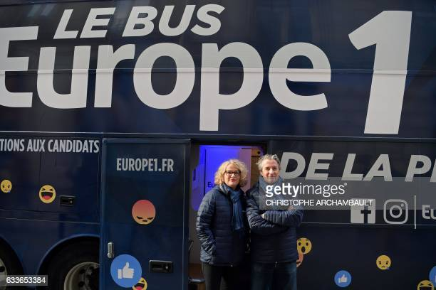 French journalists Isabelle Millet and Nicolas Poincare pose for a picture for the launch of French radio Europe 1's 'presidential bus' in Paris on...