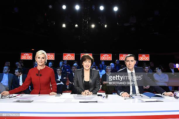 French journalists' Laurence Ferrari Ruth Elkrief and Laurent Neumann pose ahead of the second televised debate between all candidates for the French...