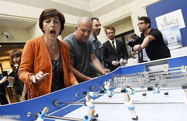 French journalists Ruth Elkrief and Philippe Dana play a women table football game as part of a meeting on the theme 'the place and the future of the...