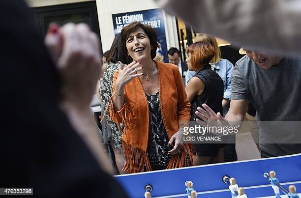 French journalists Ruth Elkrief plays a women table football game as part of a meeting on the theme 'the place and the future of the women's football...