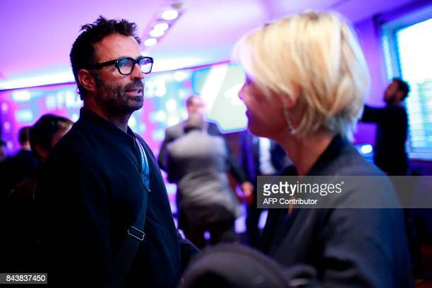 French journalists Victor Robert and Maitena Biraben talk during a conference a press conference promoting France's candidacy for the 2023 Rugby...