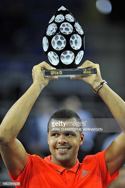 French JoWilfried Tsonga holds his trophy after defeating France's Gilles Simon during the ATP Moselle Open finals tennis match on September 27 2015...