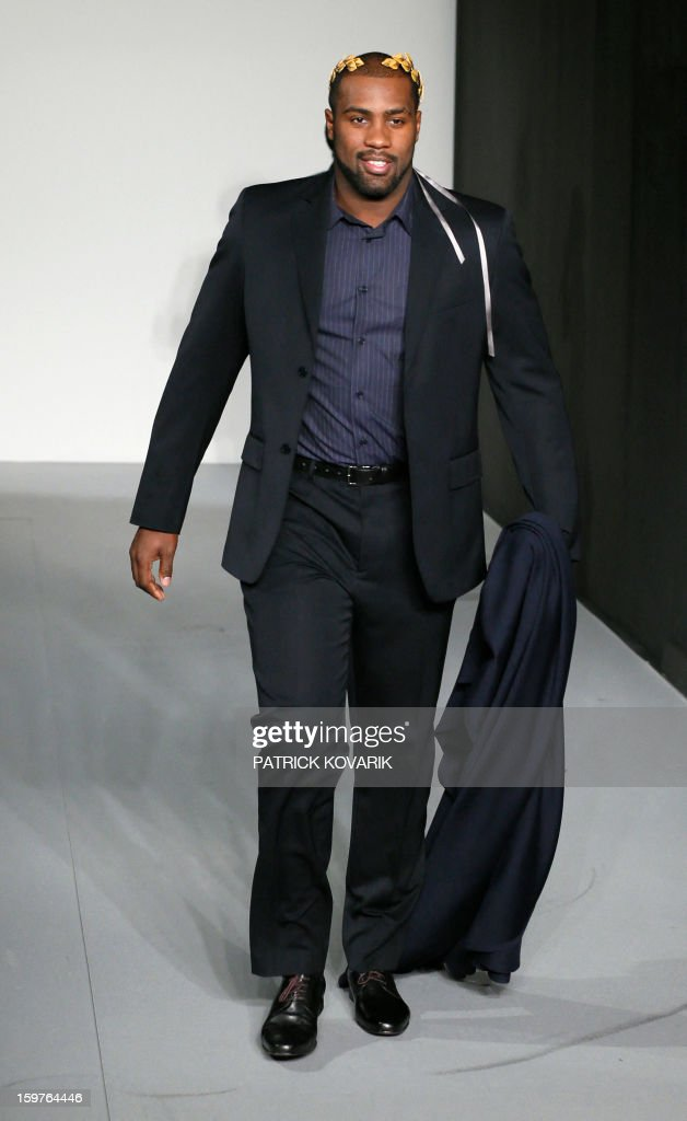 French judo champion Teddy Riner models a creation by French designer Agnes B on January 20, 2013 during the men's fall-winter 2013-2014 fashion week in Paris. AFP PHOTO / PATRICK KOVARIK