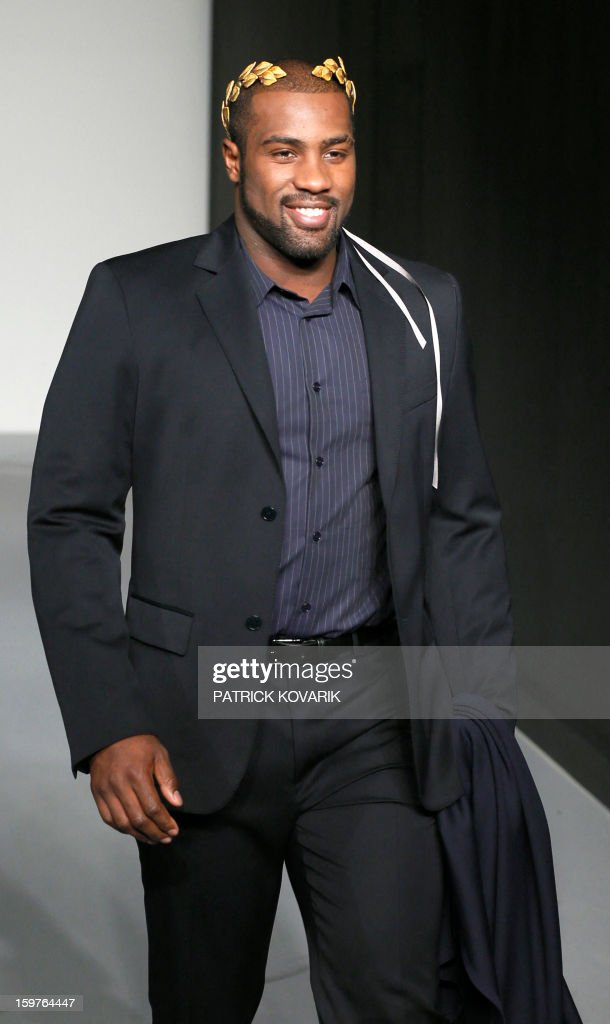French judo champion Teddy Riner models a creation by French designer Agnes B on January 20, 2013 during the men's fall-winter 2013-2014 fashion week in Paris.