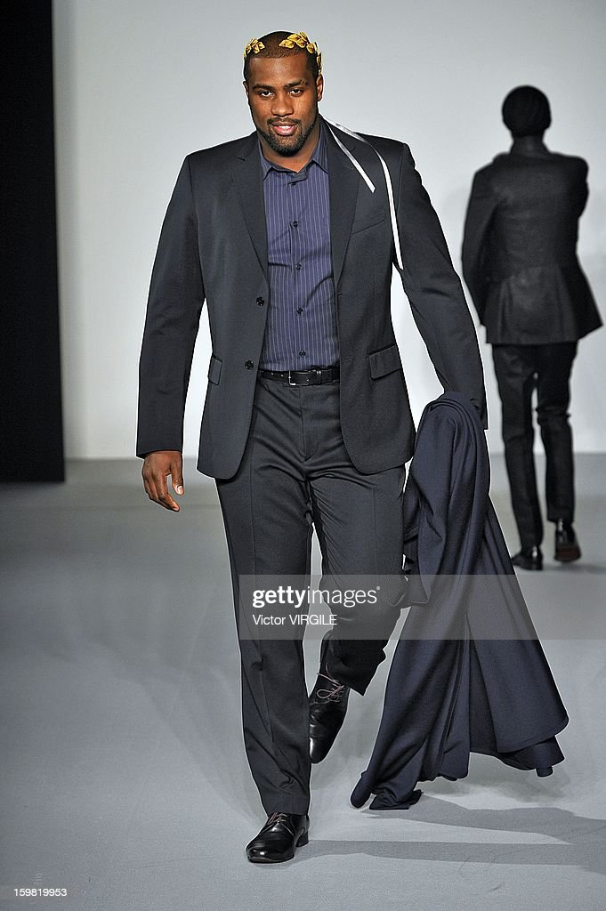 French judo champion <a gi-track='captionPersonalityLinkClicked' href=/galleries/search?phrase=Teddy+Riner&family=editorial&specificpeople=4114927 ng-click='$event.stopPropagation()'>Teddy Riner</a> walks the runway during the Agnes B Men Ready to Wear Fall/Winter 2013-2014 show as part of Paris Fashion Week on at on January 20, 2013 in Paris, France.