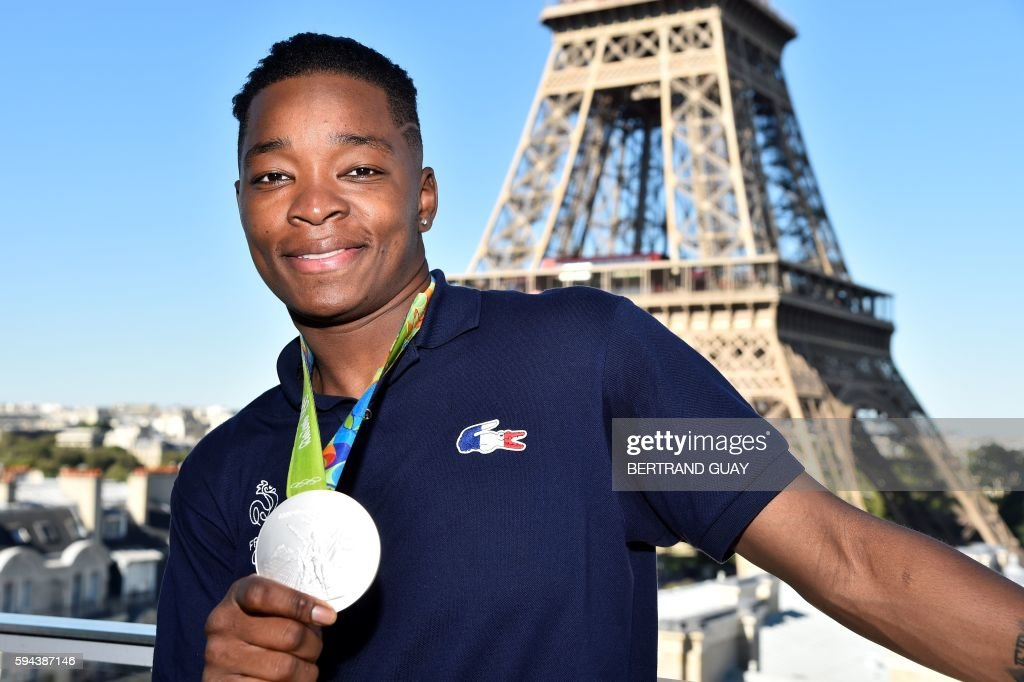 French judoka Audrey Tcheumeo poses with his silver medal on August 23 in front of the Eiffel tower in Paris France's Olympic team landed in Paris on...