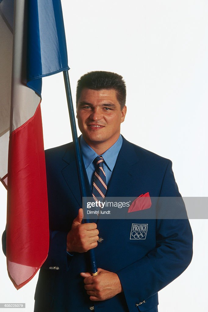 French judoka <a gi-track='captionPersonalityLinkClicked' href=/galleries/search?phrase=David+Douillet&family=editorial&specificpeople=220892 ng-click='$event.stopPropagation()'>David Douillet</a>, flag holder of the French National Team at the 2000 Olympics.
