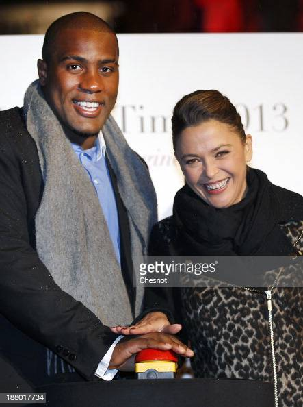 French Judoka Teddy Riner and television host Sandrine Quetier launche the Christmas Lighting at Faubourg SaintHonore on November 14 2013 in Paris...