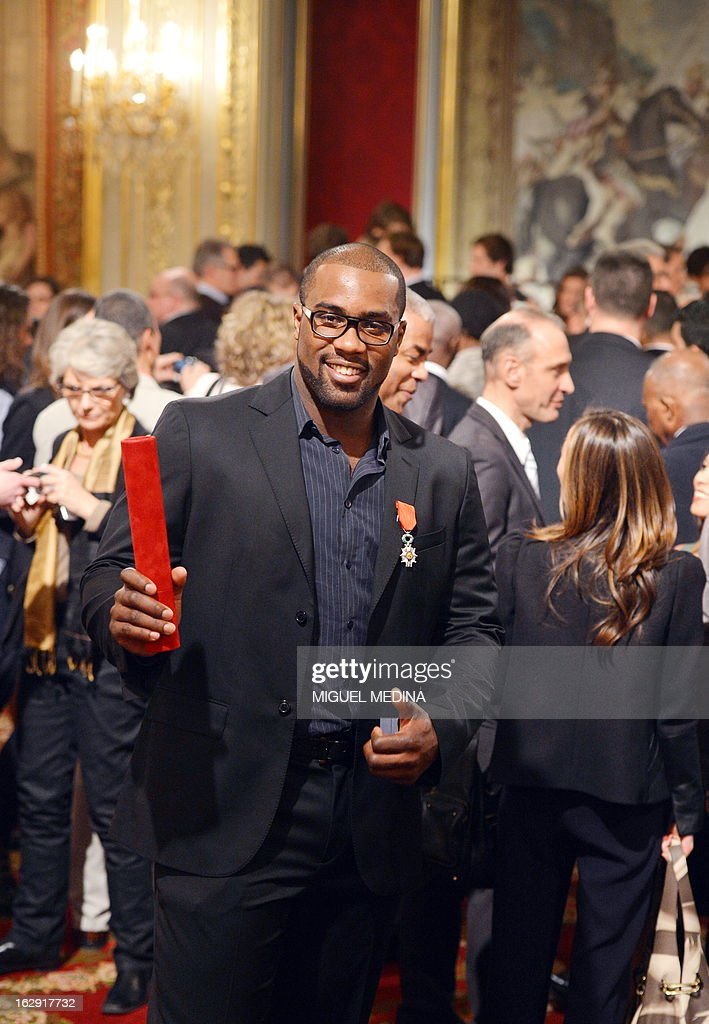 French judoka Teddy Riner, gold medalist at the 2012 London olympics games, poses after being awarded with the French Legion d'Honneur by French President Francois Hollande during a ceremony on March 1, 2013 in Paris.