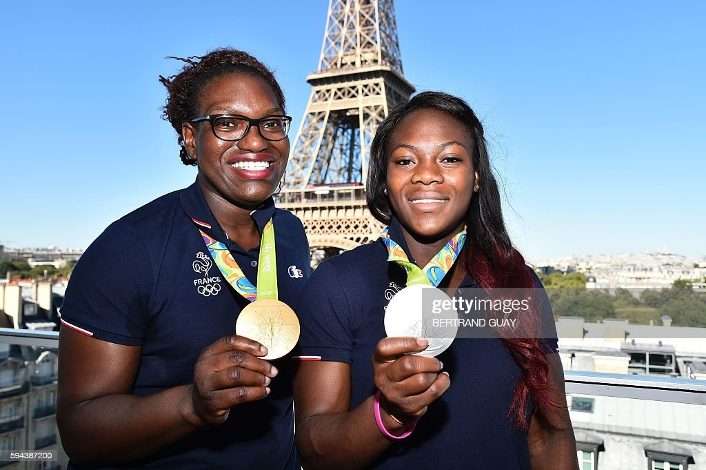 French judokas Emilie Andeol and Clarisse Agbegnenou pose with their respectively gold and silver medal on August 23 in front of the Eiffel tower in...