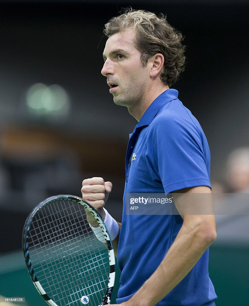 French Julien Benneteau gestures during his match against unseen Argentinian Juan Martin Del Potro during the final match of the ABN AMRO ATP World Tennis Tournament in Rotterdam on February 17, 2013. AFP PHOTO/ANP/KOEN SUYK netherlands out - belgium out