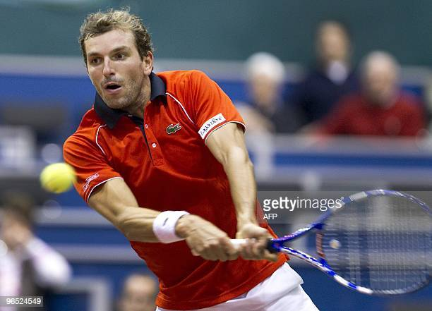 French Julien Benneteau returns the ball during his match against Croatian player Ivan Ljubicic in the first round of the ABN Amro World Tennis...