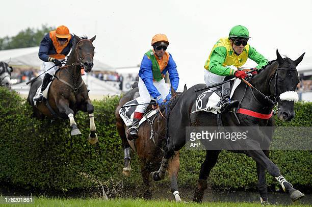 French Julien Zuliani competes on his horse horse Martalin on his way to win on August 27 2013 the yearly Waregem Koerse 'Great Steeple Chase of...