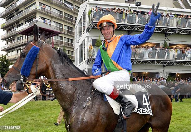 French Julien Zuliani reacts on his horse horse Martalin after winning on August 27 2013 the yearly Waregem Koerse 'Great Steeple Chase of Flanders'...
