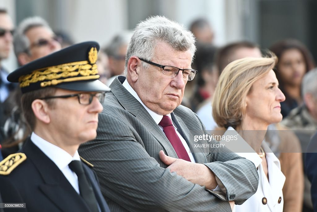 French Junior Budget Minister Christian Eckert (C) and Head of French customs Helene Crocquevieille (R) look on during the closing ceremony for the graduated class of the National School of Customs in La Rochelle on May 24, 2016. French customs services received a new training to fight against terrorism, the first 'agents of observation' of customs recruited as part of the security agreement to reinforce the numbers of judiciary, penitentiary and customs police and gendarme members. As part of this security agreement and concerning only the customs service 1,000 new positions will be created between 2016 and 2017. / AFP / XAVIER