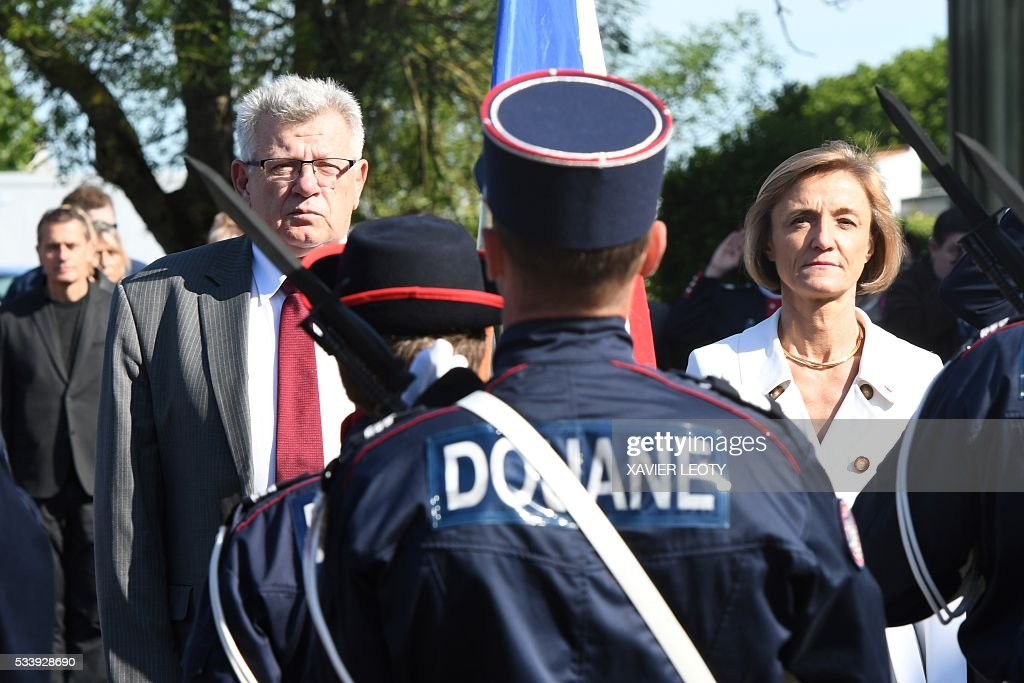 French Junior Budget Minister Christian Eckert (L) and Head of French customs Helene Crocquevieille (R) look on during the closing ceremony for the graduated class of the National School of Customs in La Rochelle on May 24, 2016. French customs services received a new training to fight against terrorism, the first 'agents of observation' of customs recruited as part of the security agreement to reinforce the numbers of judiciary, penitentiary and customs police and gendarme members. As part of this security agreement and concerning only the customs service 1,000 new positions will be created between 2016 and 2017. / AFP / XAVIER