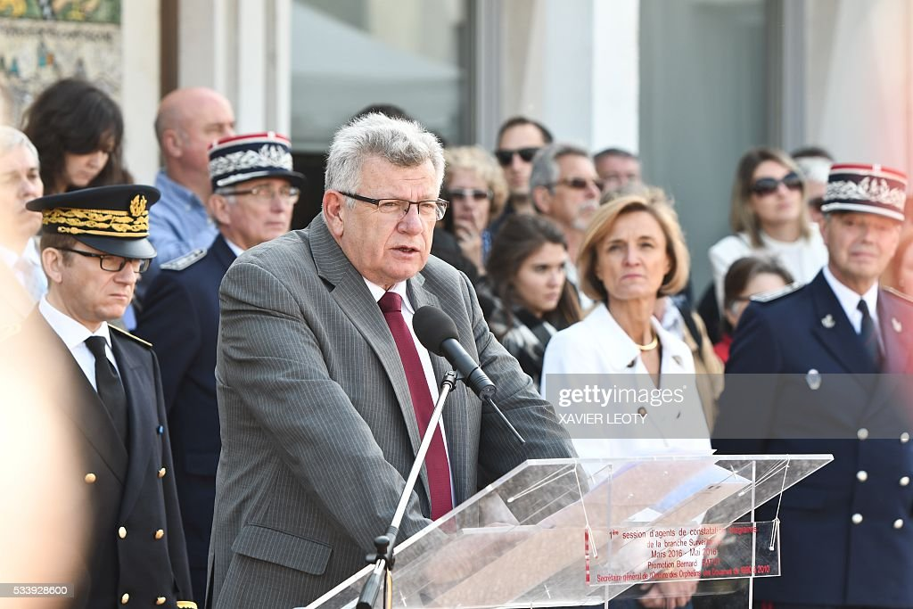 French Junior Budget Minister Christian Eckert (C), flanked by Head of French customs Helene Crocquevieille (R), delivers a speech during the closing ceremony for the graduated class of the National School of Customs in La Rochelle on May 24, 2016. French customs services received a new training to fight against terrorism, the first 'agents of observation' of customs recruited as part of the security agreement to reinforce the numbers of judiciary, penitentiary and customs police and gendarme members. As part of this security agreement and concerning only the customs service 1,000 new positions will be created between 2016 and 2017. / AFP / XAVIER