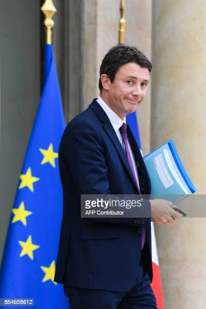 French Junior Economy Minister Benjamin Griveaux leaves the Elysee palace following the weekly Cabinet meeting on September 27 2017 in Paris / AFP...