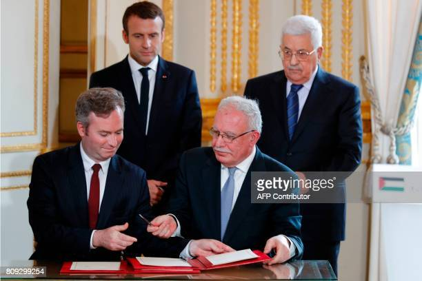 French Junior Foreign Affairs Minister JeanBaptiste Lemoyne and Palestinian Foreign Minister Riyad AlMaliki sign an agreement for the French...