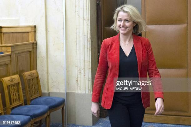 French Junior minister Barbara Pompili smiles during the second meeting of the the new ecologist party ' Ecologistes' in Paris on March 26 2016 / AFP...